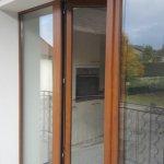 DRIA FENÊTRES_porte-fenêtre en PVC chêne doré Vaud-Genève-Neuchâtel-Fribourg